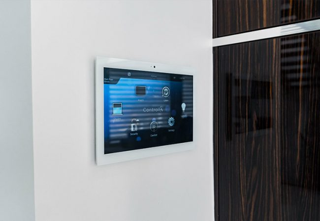 a small screen is mounted on the wall